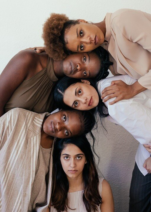 five-diverse-women-of-color-looking-at-camera