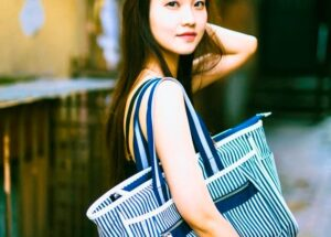 Asian- american style influencer outside holding large blue green handbag