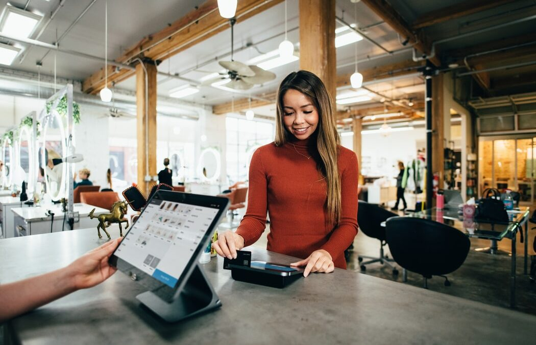 asian-female-consumer-using-credit-card-to-pay-at-checkout